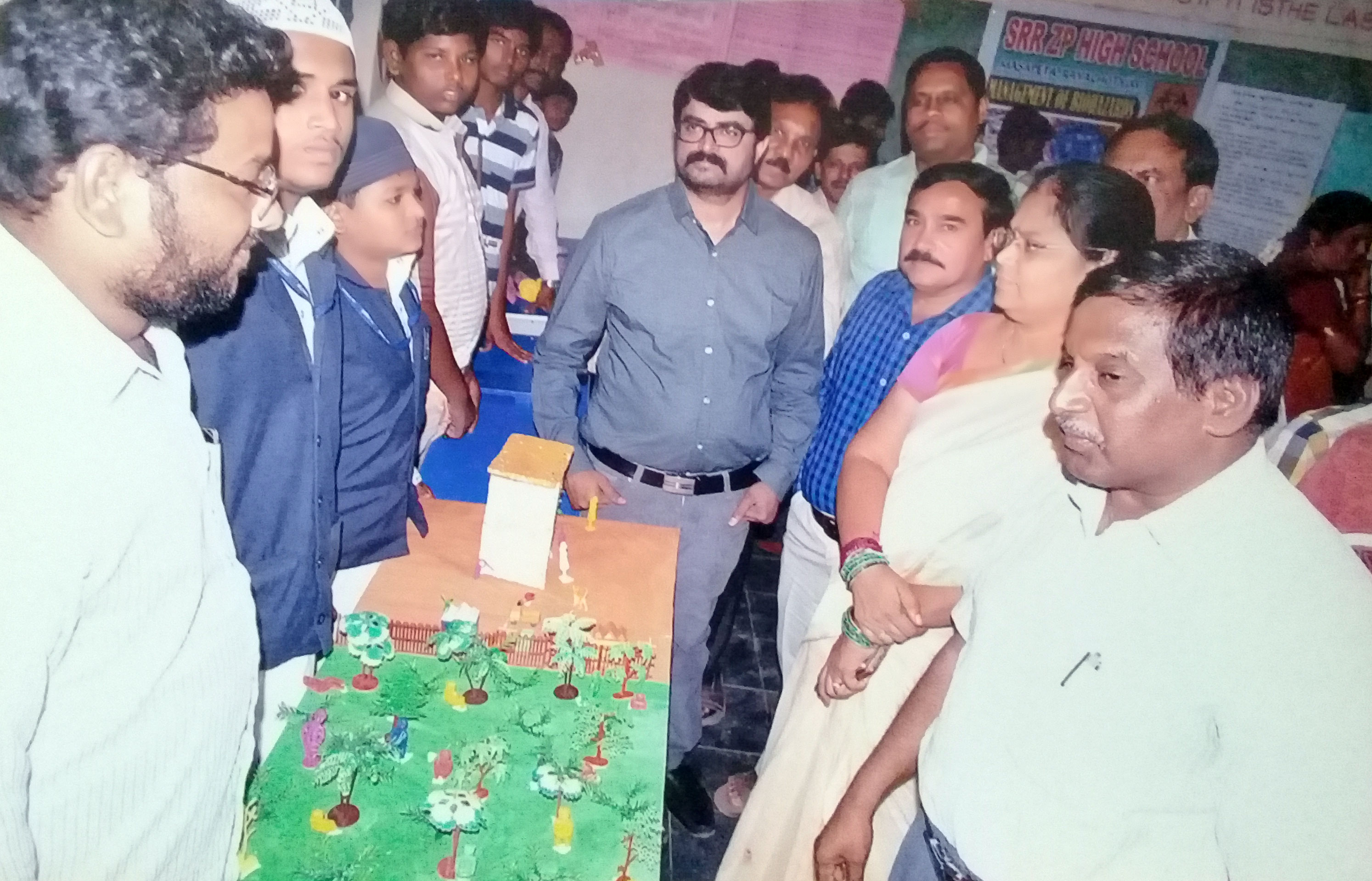 Peace School Students Explaining their project to RJD Sir, DEO Madam & Dist. Science Officer.